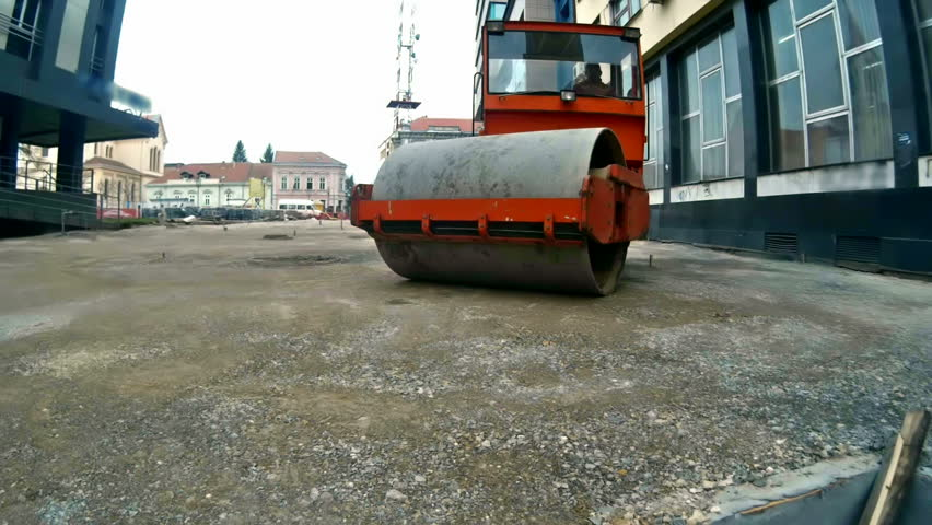 Road construction ; Road roller carried repair works on city streets,video clip