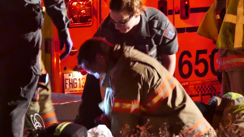 Montreal, Canada - December 2014 - 4K UHD - Closeup of fire fighter doing chest compression during CPR