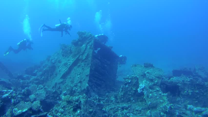 Divers inspect the wreckage of wreck ship SS Carnatic, Red Sea, Egypt