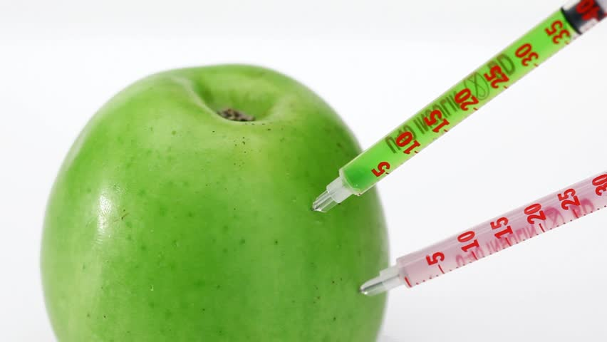 GMO apple injection with three syringe on the white background