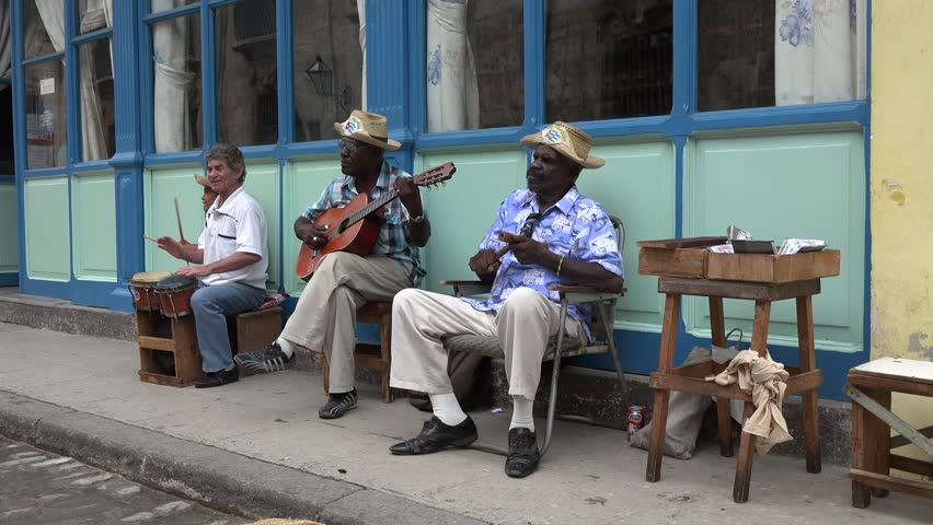 HAVANA,CUBA-JULY 15,2014: Traditional street musician playing acoustic Cuban son in  Old Havana is a Unesco World Heritage site and a tourist landmark.