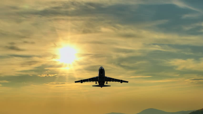 4k Huge plane flies overhead at sunrise, UHD stock video