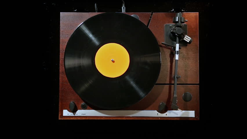 playing record on gramophone