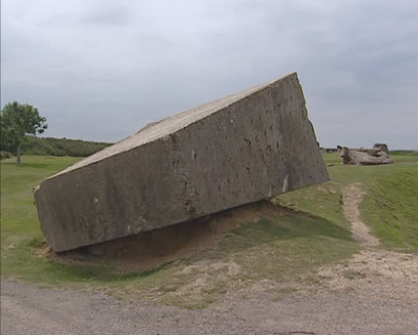 NORMANDY, FRANCE - JUNE 2005: Pointe du Hoc memorial site at Normandy coast + pan bomb craters and remains of German casemates. Atlantic ocean in background. Omaha Beach, Normandy, France. - SD stock footage clip