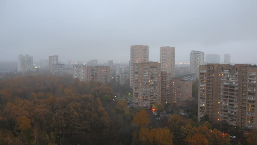 One of the districts of Moscow in foggy weather at autumn. Time lapse. - HD stock video clip