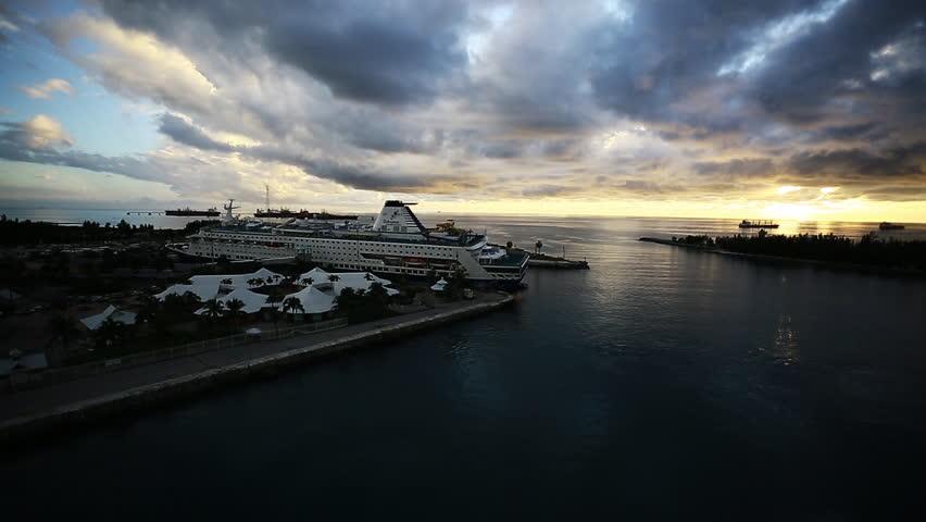 FREEPORT, BAHAMAS - NOVEMBER 12, 2014: Wide shot of a docked 'Celebration Cruise Line' cruise ship during sunset. 1080p HD.