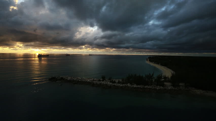 Caribbean inlet during sunset with clouds. 1080p HD.
