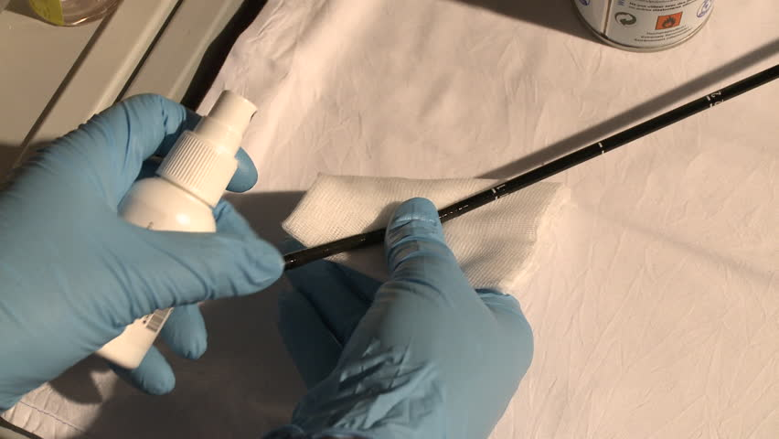 Nurse cleaning the tip of a bronchoscope in a hospital. Close Up.