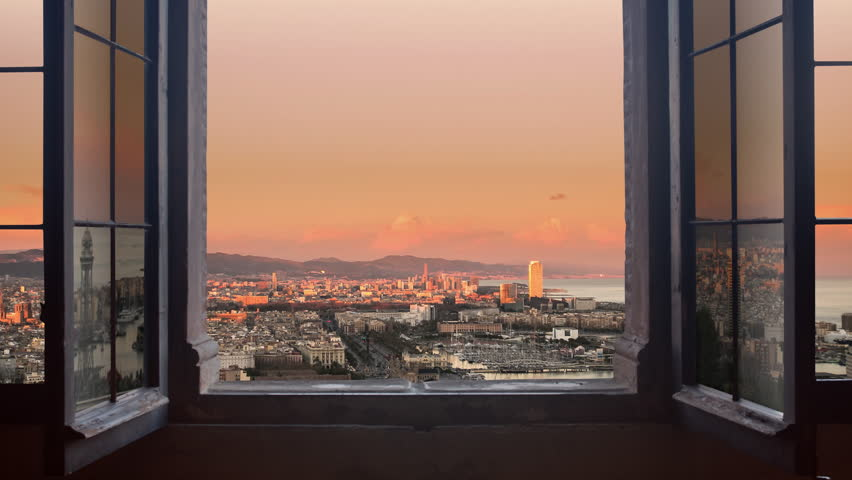 barcelona cityscape as seen from behind a window day to night timelapse at the sunset to night city lighting up panorama traffic rushing 4k - 4K stock footage clip