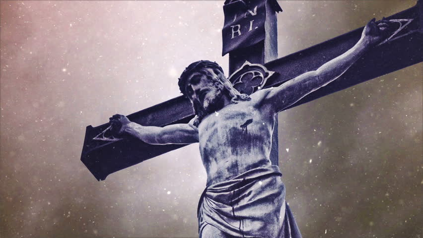Crucifixion cross with Jesus Christ statue over stormy clouds and Snow falling time lapse as Religious Christian Concept. - HD stock footage clip
