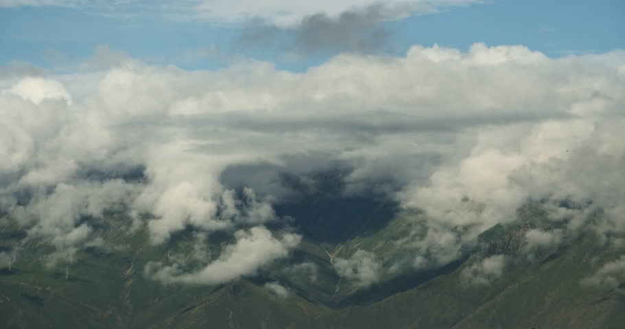 4k timelapse white puffy clouds mass rolling over Tibet mountaintop & valley,roof of the World.gh2_08730_4k