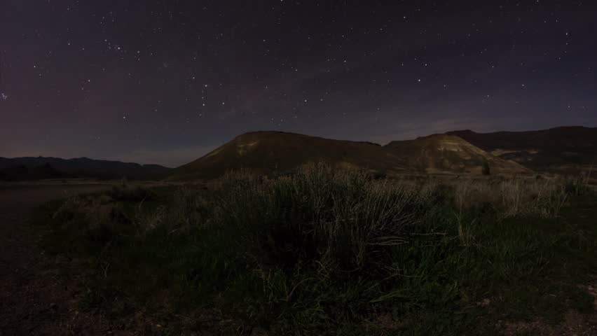 Time lapse of starry night with moonset lights at Painted Hills, Oregon