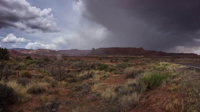 Storm clouds moving over Torrey with traffic near Capitol Reef National Park in Utah