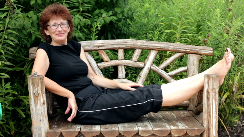 Woman relaxing on Bench waves - HD stock video clip