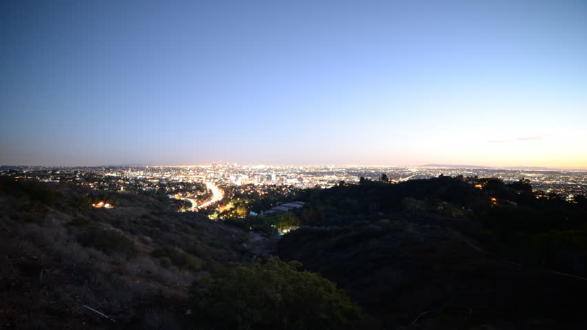 Time lapse footage of Los Angeles cityscape at twilight wide shot in Los Angeles, California