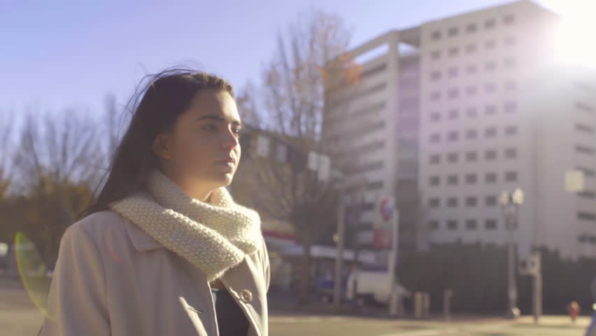 Mixed Race Young Woman Walks Through Big City On A Sunny, Windy Day (Slow Motion, Lens Flare)