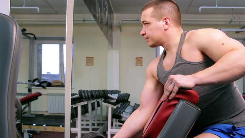 A man trains in a gym