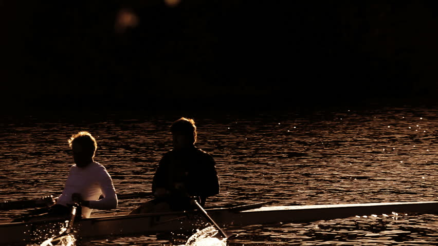 Rowing training on the river in early morning in silhouette