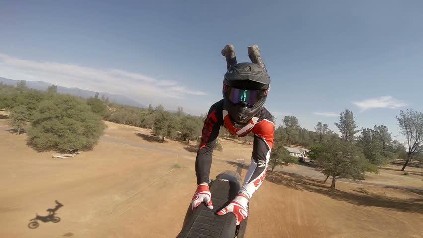 POV action camera shot of motocross rider going off jump