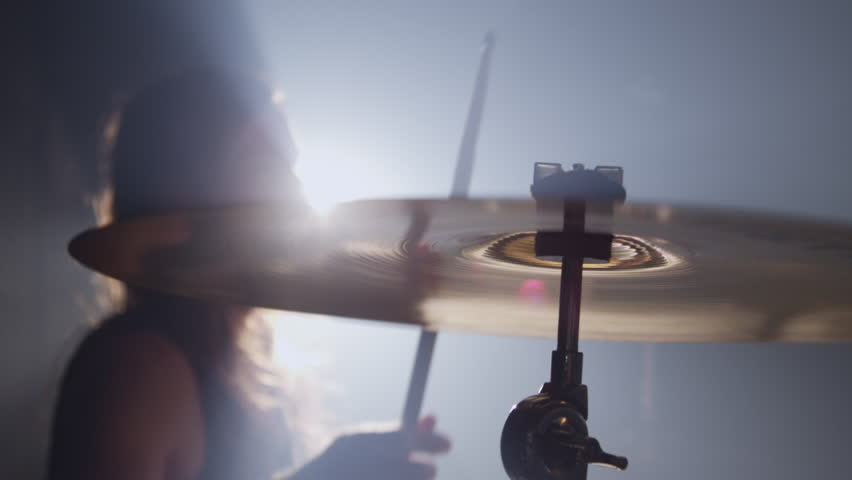 Cymbal closeup in heavy metal rock band, slow motion