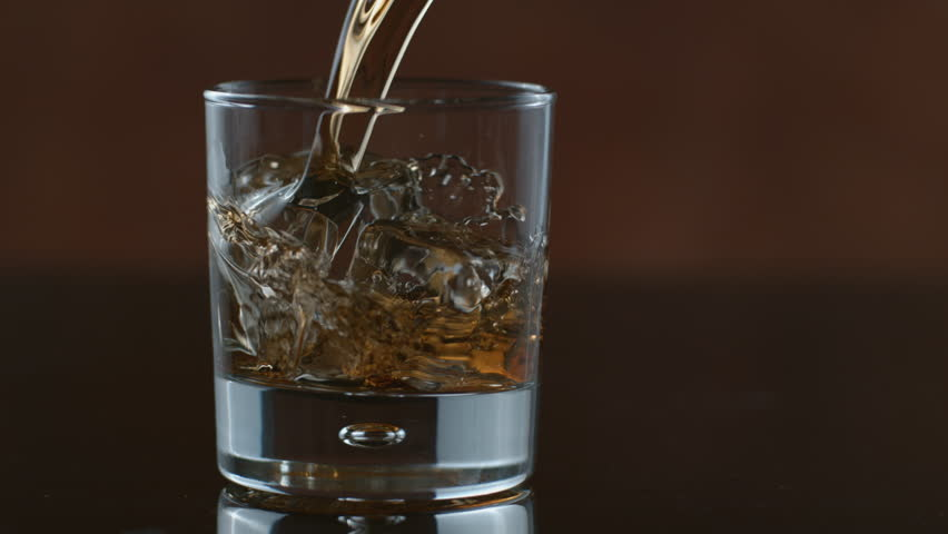 Whisky is poured over ice in slow motion; shot on Phantom Flex 4K at 1000 fps