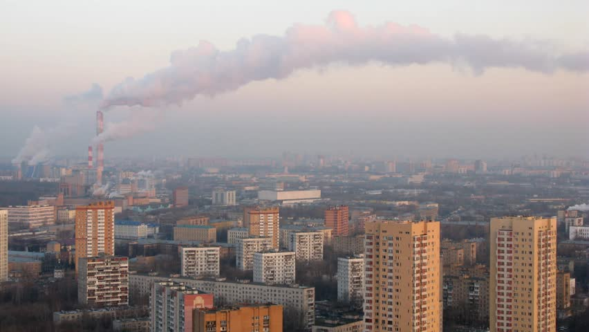 One of the districts of Moscow, smoke comes from the pipes of factories. Time lapse. 