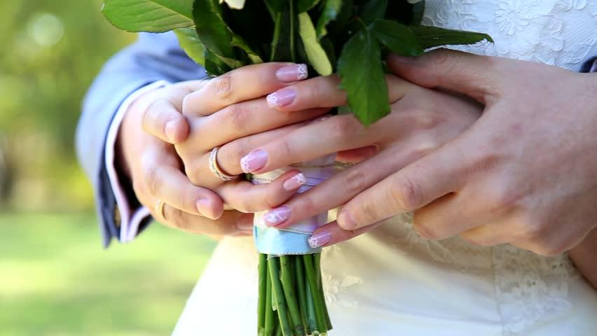 Hand holding wedding