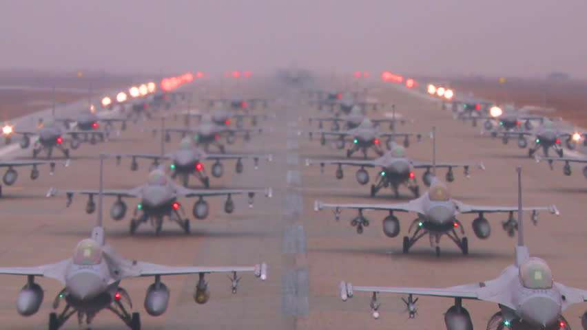 CIRCA 2010s - Zoom back from dozens of Air Force jet aircraft parked and ready on a runway.