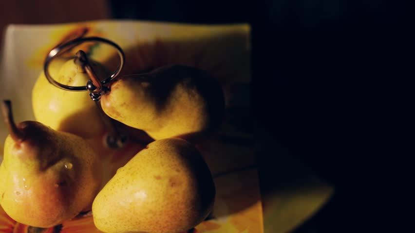 Delicious pears on a dark background