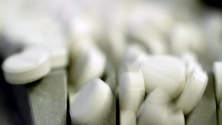 Tablets at a pharmaceutical factory are shot closeup
