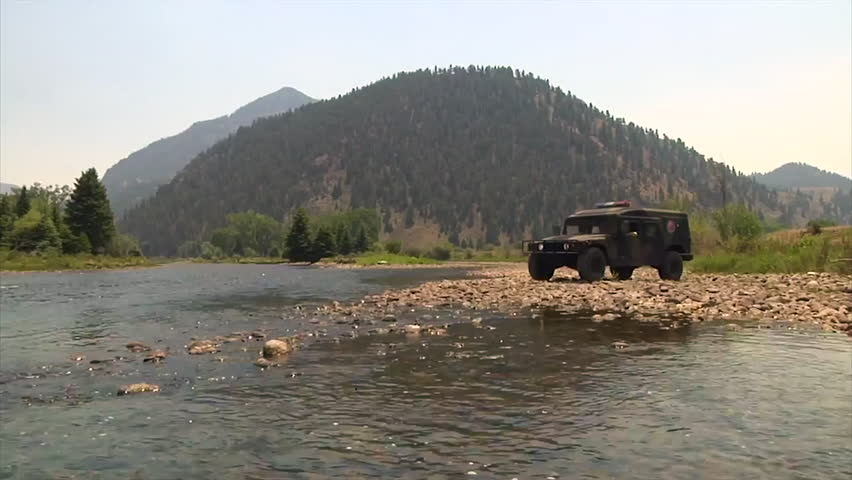 CIRCA 2010s - An emergency vehicle crosses a river in Colorado. - HD stock footage clip
