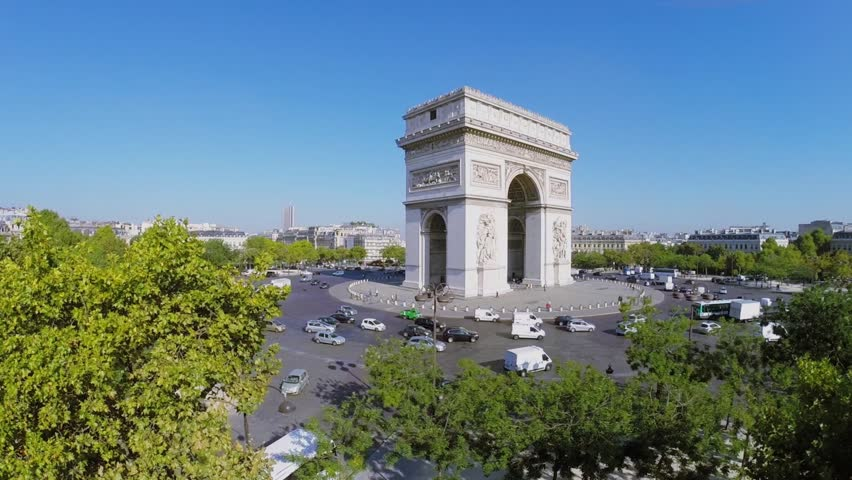 PARIS - SEP 12, 2014: Transport traffic on Place Charles de Gaulle with Arc de Triomphe at autumn sunny day. Aerial view. Arc is 50 meters high.