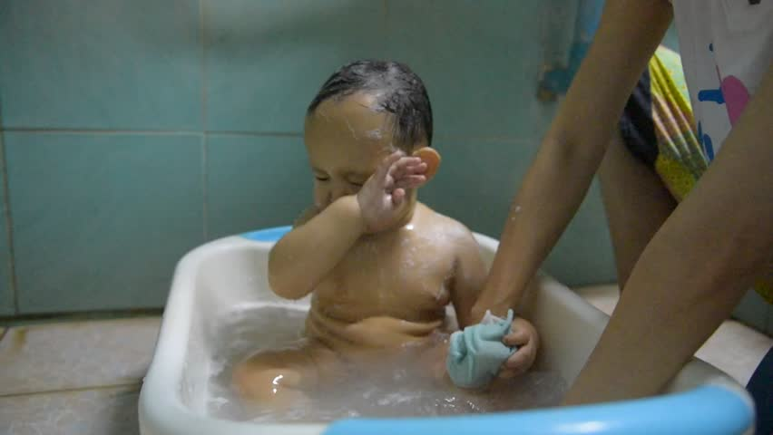 2 year old toddler boy having his hair washed in a bathtub stock footage video 13581098. Black Bedroom Furniture Sets. Home Design Ideas