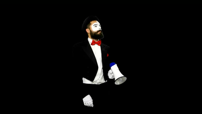 Funny, bearded, young man mime using white speaker and crying something to somebody on alpha channel
