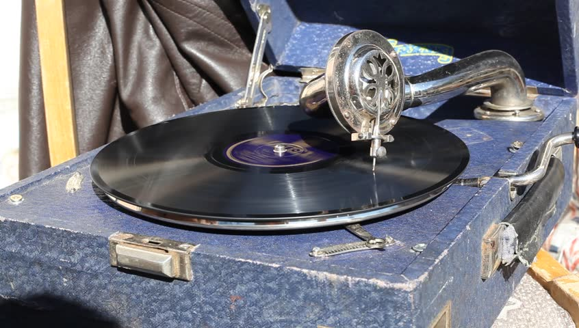 record playing in gramophone