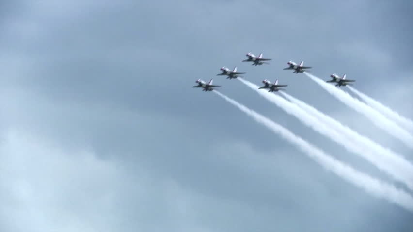 CIRCA 2010s - The Blue Angels fly in formation at an airshow.