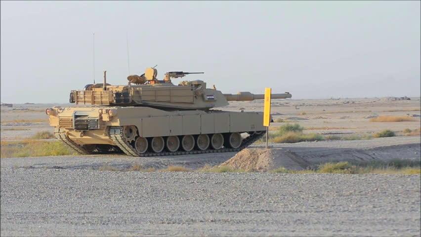 CIRCA 2010s - Abrams tanks fires during the Iraq War.