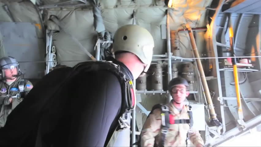 CIRCA 2010s - Paratroopers jump from an airplane. - HD stock video clip
