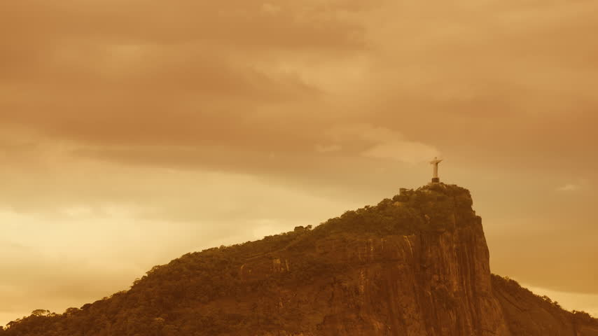 Corcovado Hill and Christ with clouds dynamic in Rio de Janeiro,Brazil. Time lapse shot with warm colors. - 4K stock footage clip