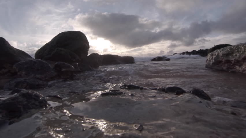 HAWAII - CIRCA 2015 - Water level view of waves crashing and rolling into shore in slow motion. | Shutterstock HD Video #9188051