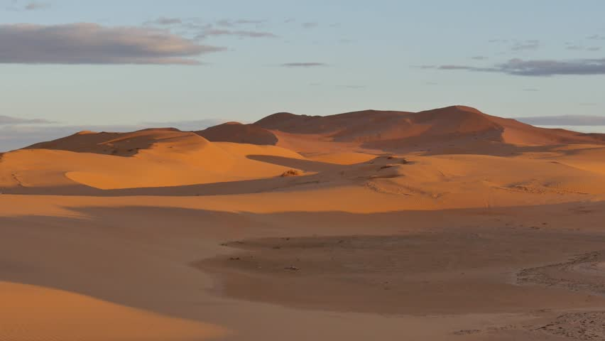 Desert dunes at sunset. Erg Chebbi, Morocco, Africa. | Shutterstock HD Video #9201137
