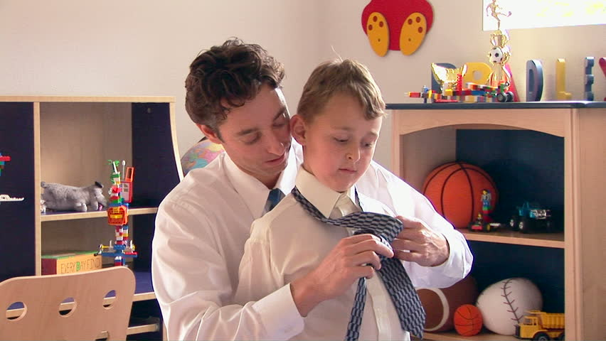 Father helping his son with tie