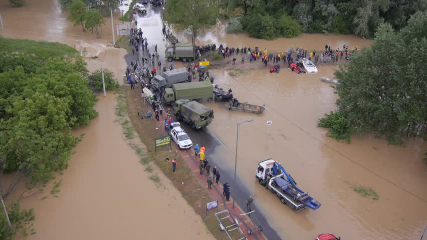 Obrenovac, Serbia May 2014. Army and police rescue teams saving people from heavy floods.