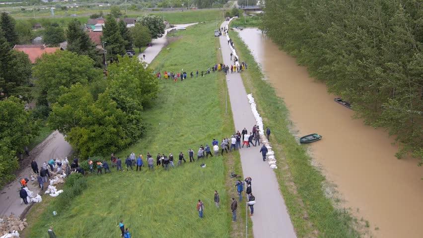 Serbia 2014. - Volunteers and soldiers filling sandbags to stop heavy floods.
