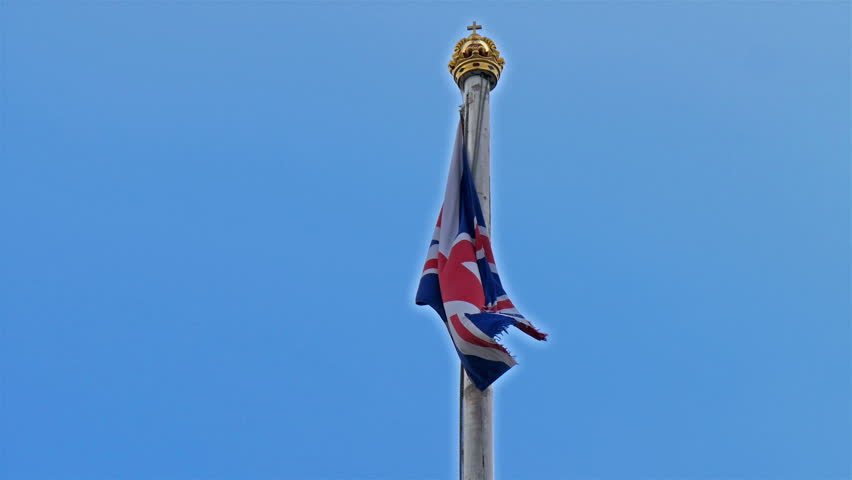 The flag pole with the golden crown in Buckingham Palace. There is an England flag waving - 4K stock footage clip
