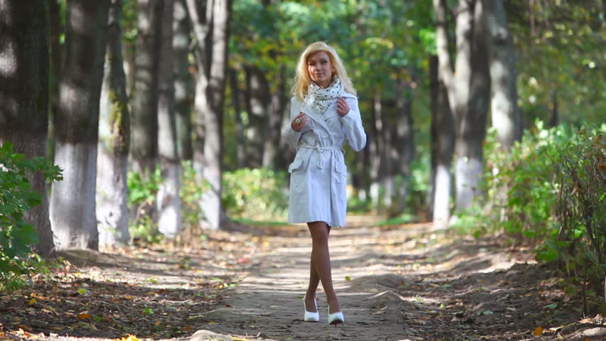 young woman walking in park two versions sequentially