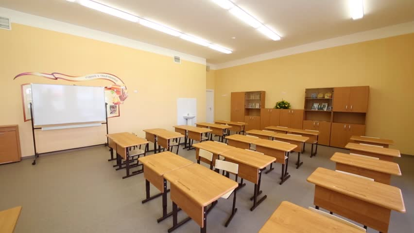 Modern Day Classroom ~ New modern school classroom with chairs on desks at sunny