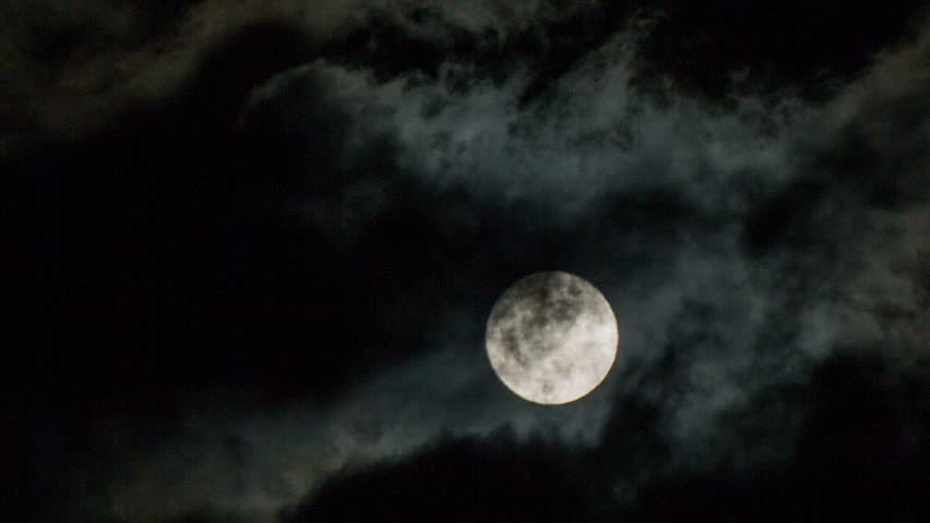 Moon behind the clouds at night close up.Night shot of cloudy weather and fool moon bright in the sky. - HD stock video clip