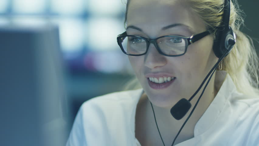 Woman Operator in Customer Support Service Center. Shot on RED Cinema Camera in 4K (UHD).