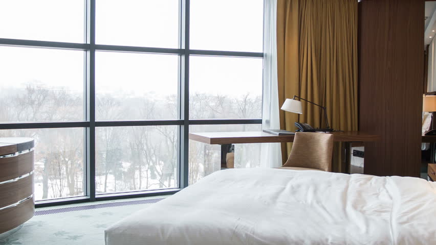 Elegant room with spectacular winter view. Shot entering a luxurious hotel bedroom. | Shutterstock HD Video #9399803